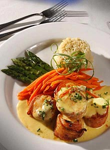 <p>One of the many tempting signature entrees.....Anchorage Scallops.</p>